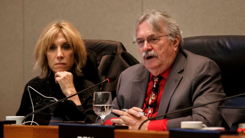 CalPERS board member J.J. Jelincic, right, during a board meeting in December. Fellow member Dana Hollinger is at left.
