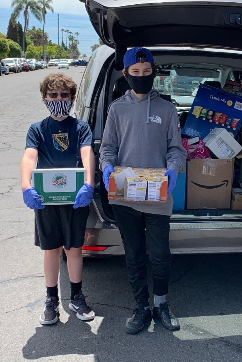 Zac and Asher Swazey delivering donations to Barrio Logan neighbors.
