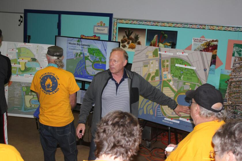 Scott Chipman demonstrates the even-handedness of his Mission Bay Gateway Plan to interested audience members at the PB Town Council meeting, Nov. 14.