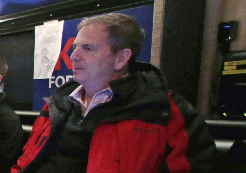 In this Jan. 20, 2016 file photo, John Weaver is shown on a campaign bus in Bow, N.H. The Lincoln Project was launched in November 2019 as a super PAC that allowed its leaders to raise and spend unlimited sums of money. In June 2020, members of the organization's leadership were informed in writing and in subsequent phone calls of at least 10 specific allegations of harassment against co-founder John Weaver, including two involving Lincoln Project employees, according to multiple people with direct knowledge of the situation. (AP Photo/Charles Krupa)
