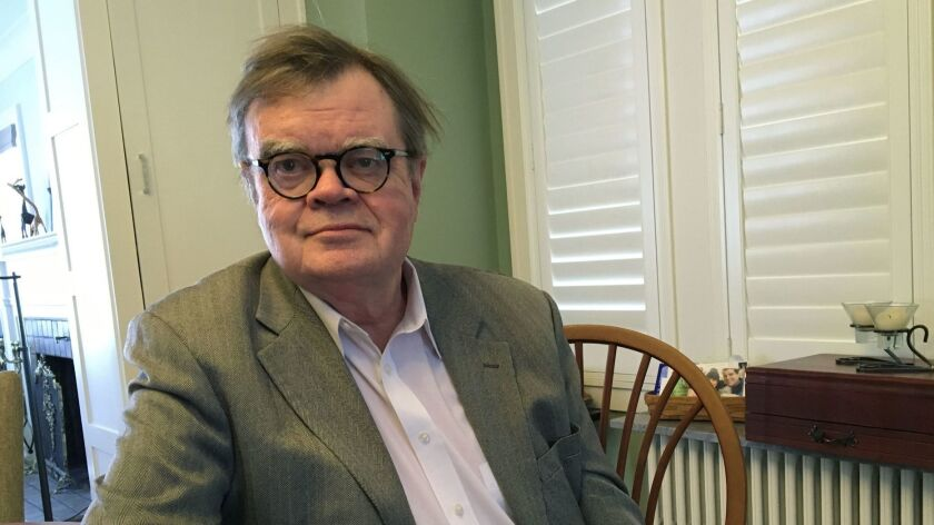 FILE - In this, Feb. 23, 2018, file photo, Garrison Keillor poses for a photo in Minneapolis. An app