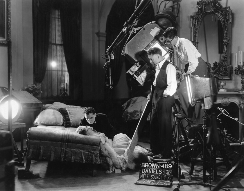 "Greta Garbo, Gavin Gordon, director Clarence Brown and cinematographer William Daniels on the set of the 1930 movie ""Romance."""