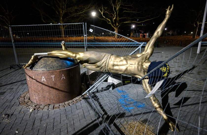 The statue of former Galaxy star Zlatan Ibrahimovic lies toppled in Malmo, Sweden, after being vandalized Saturday night.