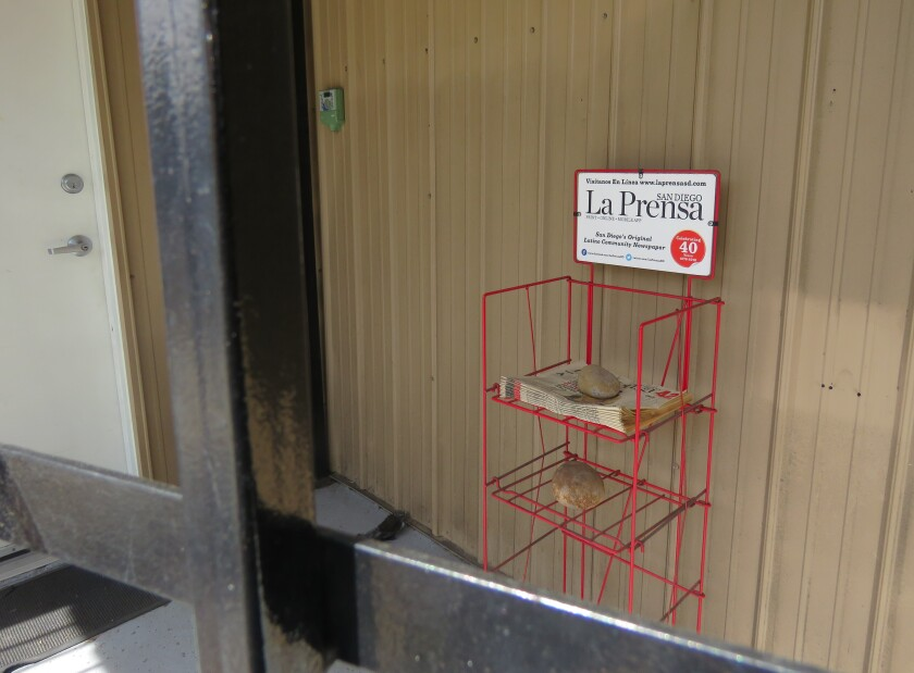 A newspaper rack outside the office of La Prensa San Diego, the region's weekly bilingual newspaper.