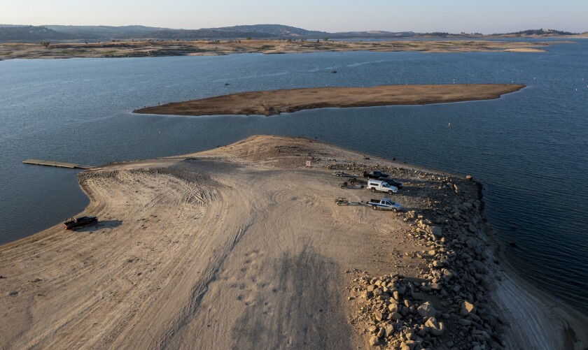 A peninsula is exposed as water levels recede at drought-stricken Folsom Lake in California.