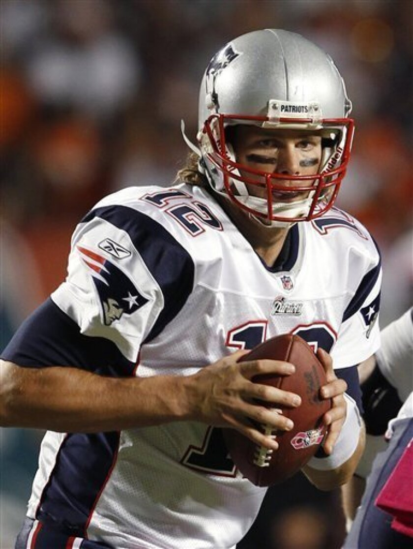 New England Patriots quarterback Tom Brady drops back to pass during the first quarter of an NFL football game against the Miami Dolphins, Monday, Oct. 4, 2010, in Miami. The Patriots defeated the Dolphins 41-14. (AP Photo/Wilfredo Lee)