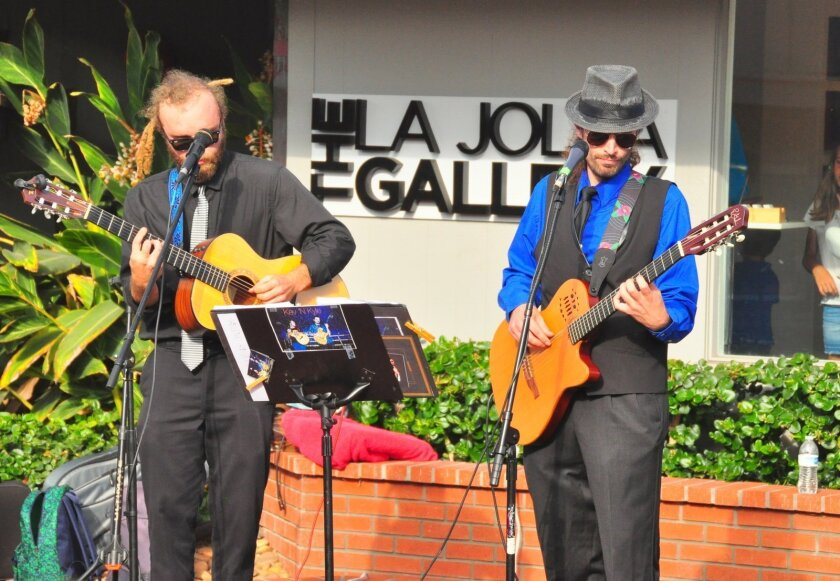 Kev N Kyle performs in front of Eddy V's and The La Jolla Gallery.