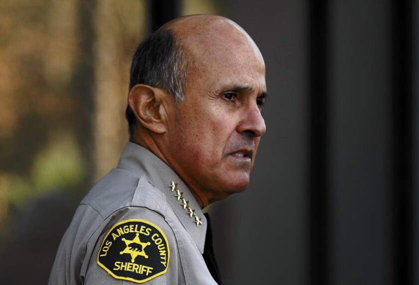 Attorneys for Deputy James Sexton say FBI agents tried to get him to record conversations with Sheriff Lee Baca, above, and Sexton's father, Ted, whom Baca recruited to serve as the department's homeland security chief.