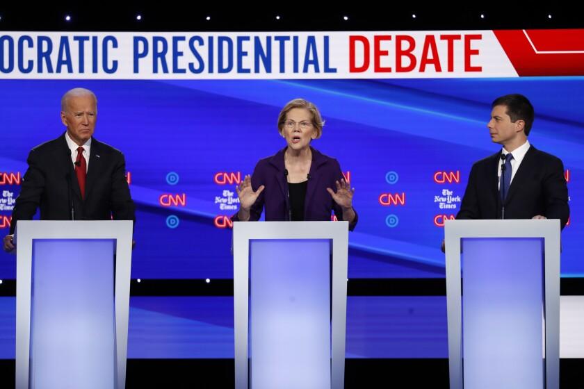 Democratic presidential candidates Joe Biden, Elizabeth Warren and Pete Buttigieg at the Oct. 15 primary debate at Otterbein University in Westerville, Ohio.