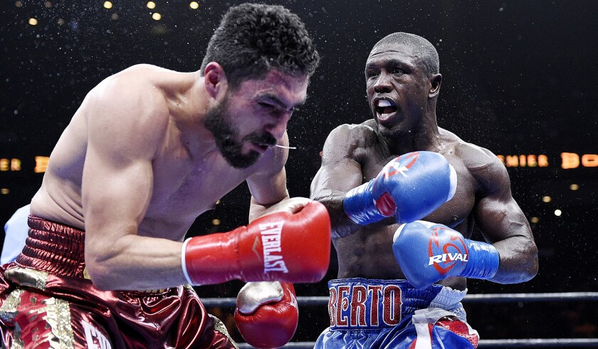 Andre Berto, right, shown in action against Josesito Lopez in 2015, has dropped the price of his Beverly Hills home again