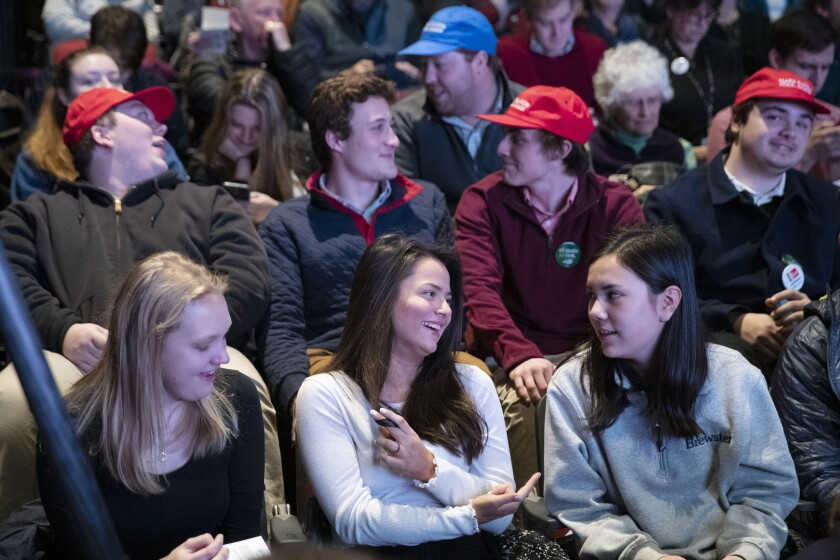 Students from local high schools and universities sit in the audience as they wait for the next speaker during the New Hampshire Youth Climate and Clean Energy Town Hall, Wednesday, Feb. 5, 2020, in Concord, N.H. (AP Photo/Mary Altaffer)