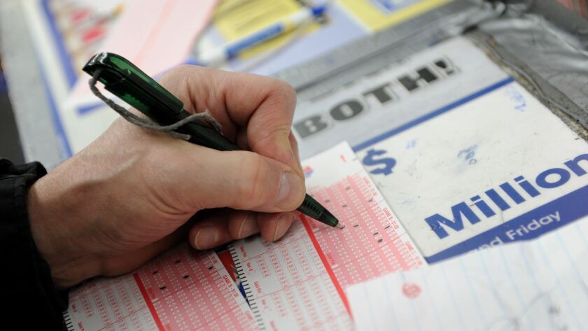 Tom Killie fills out his numbers for Mega Millions lottery tickets at a convenience store on the eas