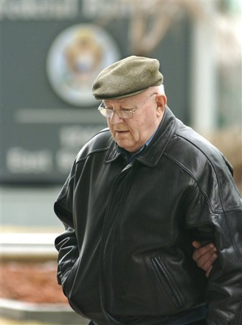 In this Feb. 28, 2005 file photo, John Demjanjuk arrives at the federal building in Cleveland for an immigration hearing. German prosecutors say doctors have determined that John Demjanjuk is fit to stand trial over allegations that he was an accessory to murder at a Nazi death camp. Munich prosecutors say in a statement Friday July 3, 2009 that they expect to file formal charges later this month. They say doctors have determined the 89-year-old is fit to face trial on condition that court sessions do not exceed two 90-minute periods per day. The retired auto worker is accused of being an accessory to murder in 29,000 cases at the Sobibor camp. The longtime Ohio resident was deported in May after losing a court battle to stay in the United States. (AP Photo/Mark Duncan)
