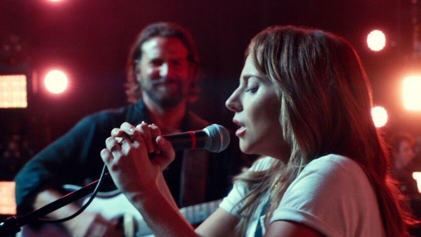 """(L-R) - Bradly Cooper and Lady Gaga in a scene from """"A Star is Born."""" Credit: Warner Bros. Pictures"""