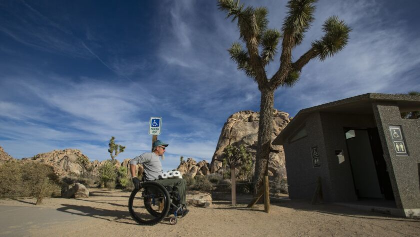 JOSHUA TREE, CA - JANUARY 8, 2019: Wheelchair bound Rand Abbott,55, of Joshua Tree carries extra toi