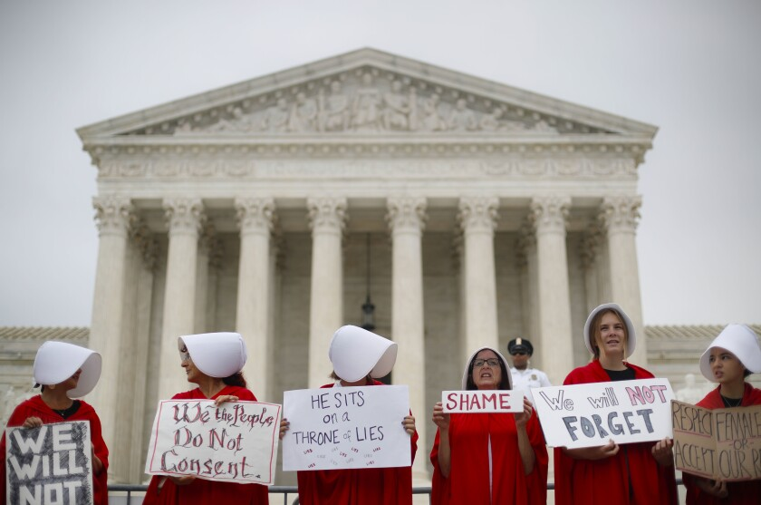 Activists protest in front of the Supreme Court in Washington on Oct. 9, 2018.