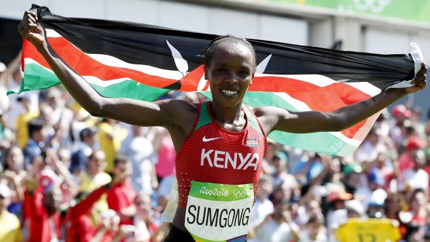Jemima Sumgong celebrates after winning the women's marathon on Sunday.