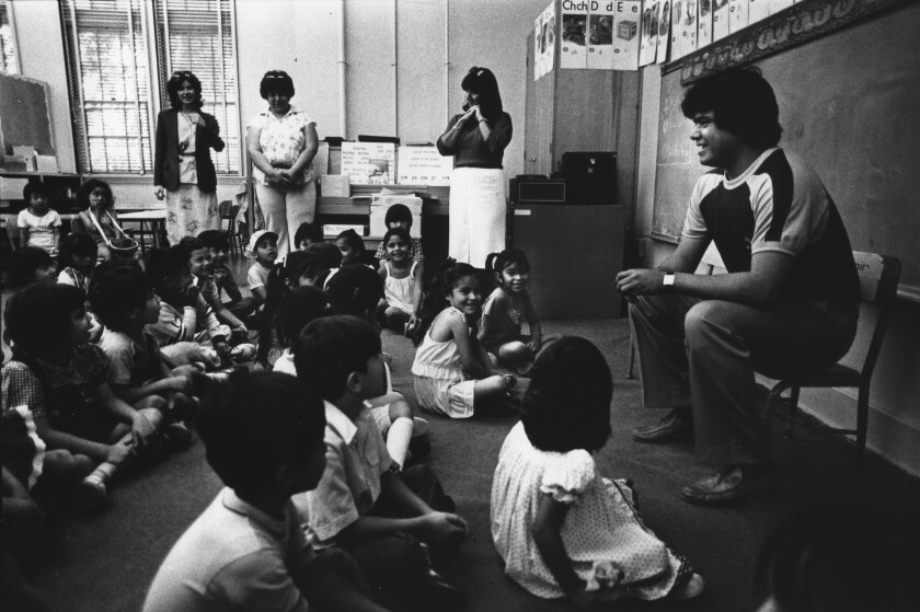 Los Angeles Dodgers pitcher Fernando Valenzuela with kindergarten students at Aldama Elementary School in Highland Park.