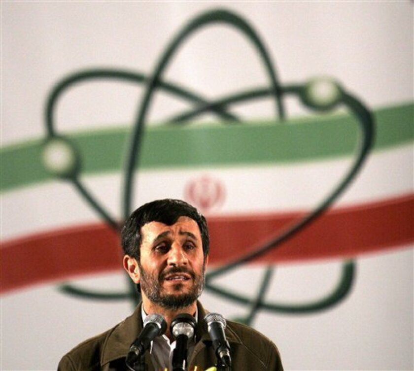 FILE- In this April, 9, 2007, file photo Iranian President Mahmoud Ahmadinejad, speaks at a ceremony in Iran's nuclear enrichment facility in Natanz, 300 kms 186 (miles) south of capital Tehran, Iran. For the first time in nearly two decades of escalating tensions over the Iranian nuclear program, it appears that world leaders are genuinely concerned that an Israeli military attack on the Islamic Republic could be imminent, an action that many fear might trigger war, terrorism and global economic havoc. (AP Photo/Hasan Sarbakhshian, File)