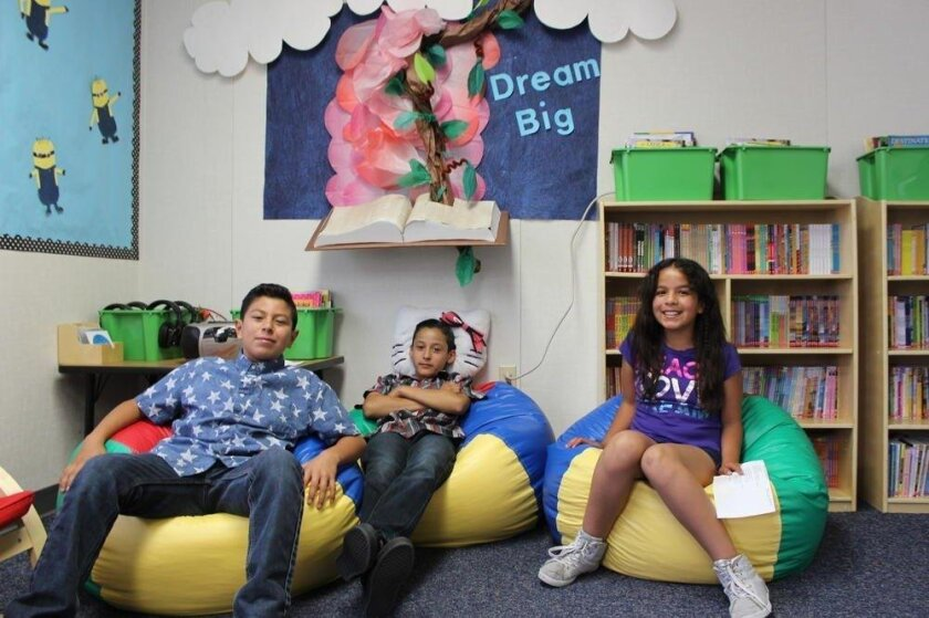 Children enjoy the beanbag chairs and colorful surroundings in the Reading Oasis at Maryland Elementary.