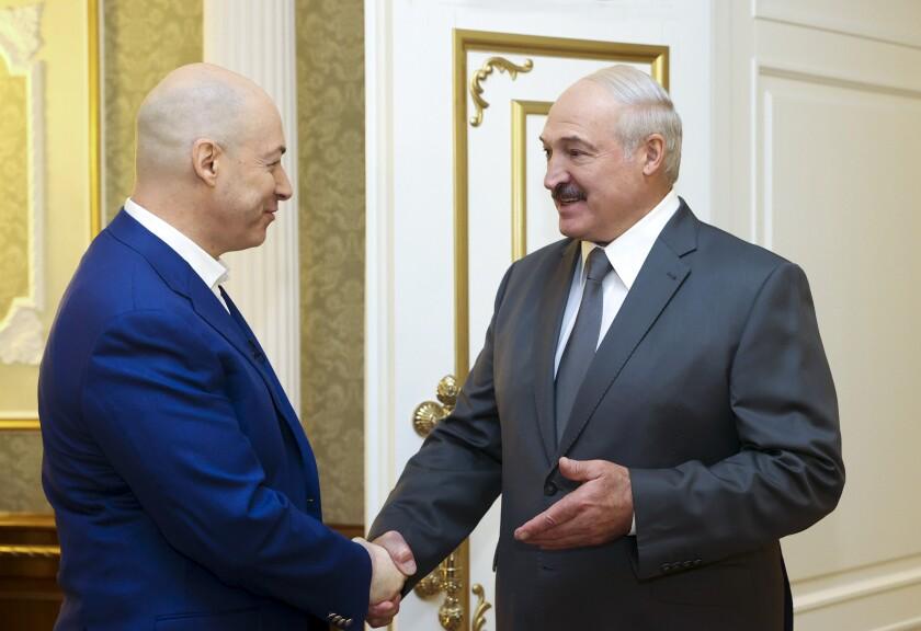 Belarusian President Alexander Lukashenko, right, shakes hand with Ukrainian journalist Dmitro Gordon prior to his interview in Minsk, Belarus, Wednesday, Aug. 5, 2020. (Nikolai Petrov/BelTA, Pool Photo via AP)