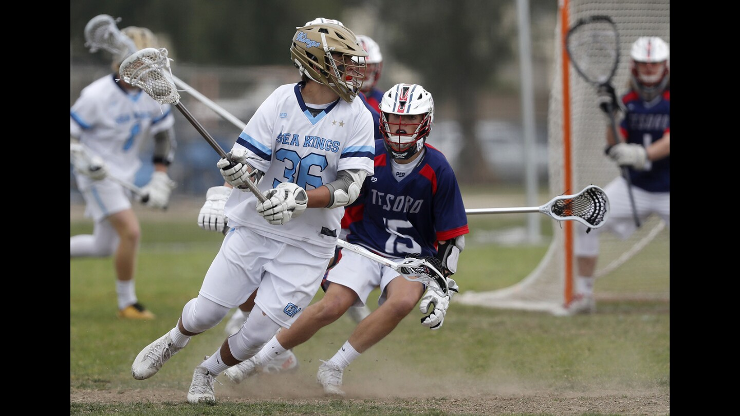 Corona del Mar High's Ryan Rector, left, competes against Tesoro during the first half in a nonleague game on Saturday, March 31.