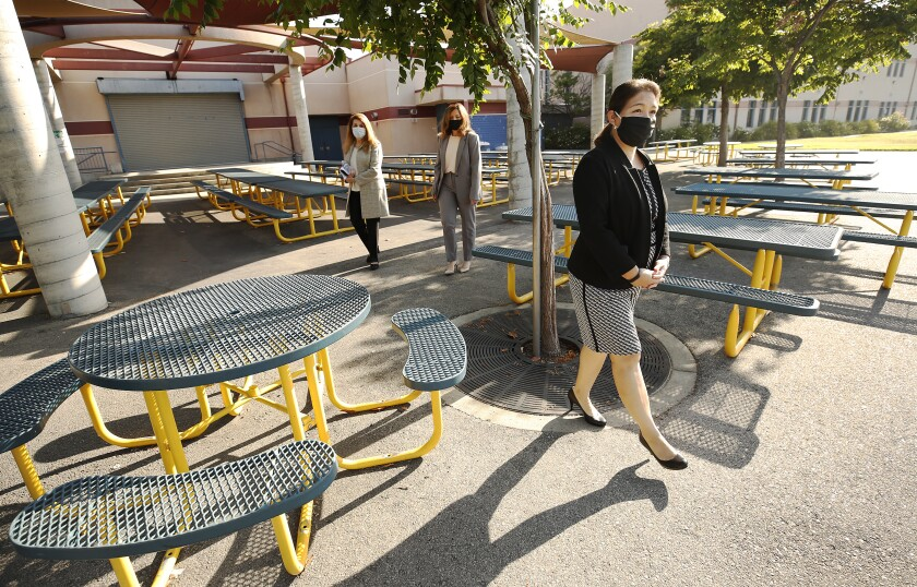 Perla Chavez-Fritz, foreground, principal of Cerritos Elementary in Glendale, looks over an outdoor lunch eating area.