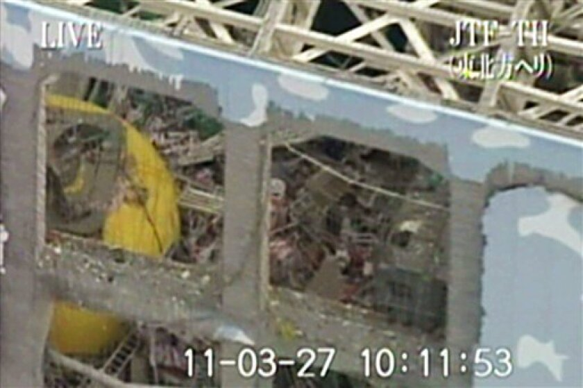 This image released by Japan Ground Self-Defense Force via Kyodo News shows Unit 4 at the stricken Fukushima Dai-ichi nuclear power plant in Okumamachi, Fukushima Prefecture, northeastern Japan, Sunday, March 27, 2011. (AP Photo/Japan Ground Self-Defense Force via Kyodo News) JAPAN OUT, MANDATORY CREDIT, NO LICENSING IN CHINA, HONG KONG, JAPAN, SOUTH KOREA AND FRANCE