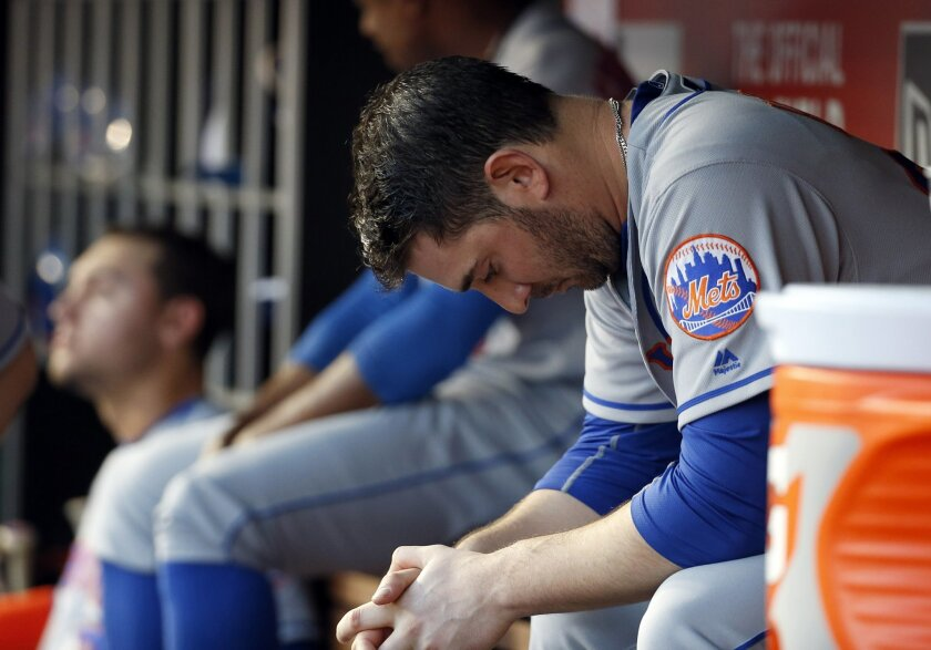 New York Mets starting pitcher Matt Harvey sits in the dugout during the fourth inning of a baseball game against the Washington Nationals at Nationals Park, Tuesday, May 24, 2016, in Washington. (AP Photo/Alex Brandon)