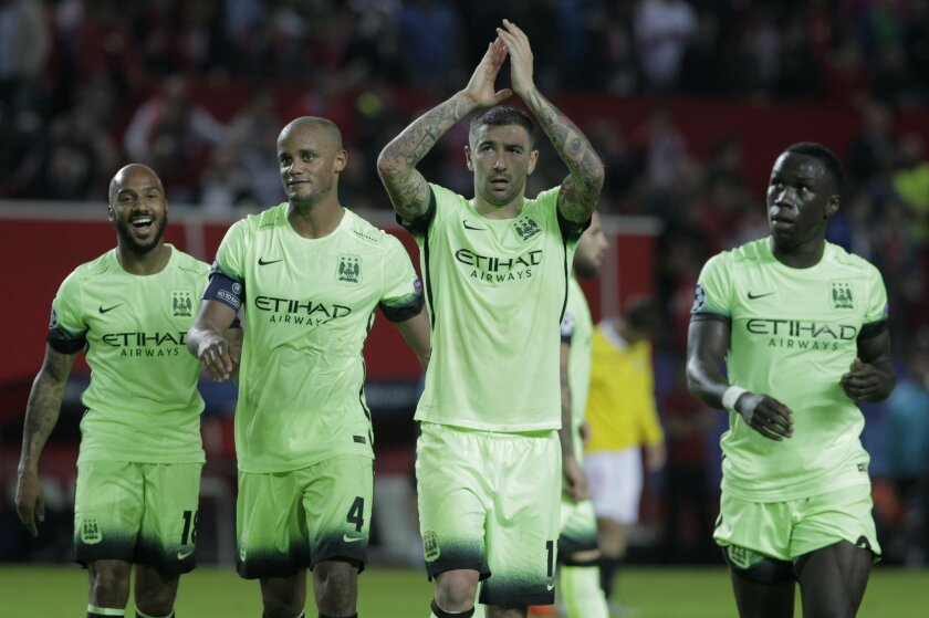 Manchester City team players applaud the fans at the end of the Group D Champions League soccer match between Sevilla and Manchester City at the Ramon Sanchez-Pizjuan stadium in Seville, Spain, Tuesday Nov. 3, 2015. Manchester City won the match 3-1. (AP Photo/Miguel Angel Morenatti)