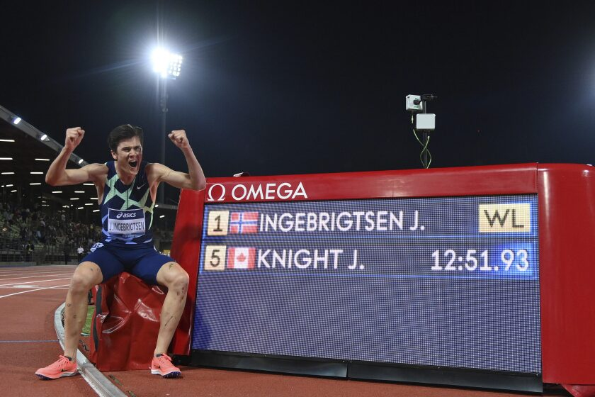 Norway's Jakob Ingebrigtsen celebrates winning the men's 5000 meters event at the Diamond League track and field meeting in Florence, Italy, Thursday, June 10, 2021. (Alfredo Falcone/LaPresse via AP)