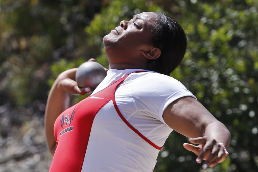 Mount Miguel junior Laulauga Tausaga delivers a toss of 48 feet, 3½ inches to set a San Diego Section record in the girls shot put Saturday at Mt. Carmel High. As a top-three finisher, Tausaga will advance to the CIF State Championships next weekend.