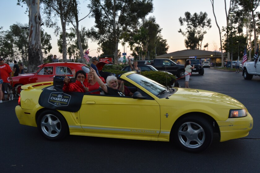 Elvis impersonator Todd Torres, his wife Tawnya, Ruthie Lawrence and Mike at the Ramona American Graffiti Cruise Night.