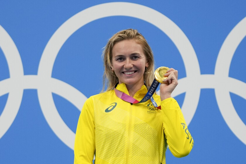 Ariarne Titmus, of Australia holds up her medal after winning the final of the women's 400-meters freestyle at the 2020 Summer Olympics, Monday, July 26, 2021, in Tokyo, Japan. (AP Photo/Matthias Schrader)