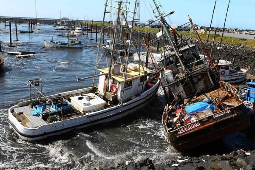 Boats collide with one another after a tsunami surge of water swept through a boat basin in Crescent City, Calif., on March 11, 2011.
