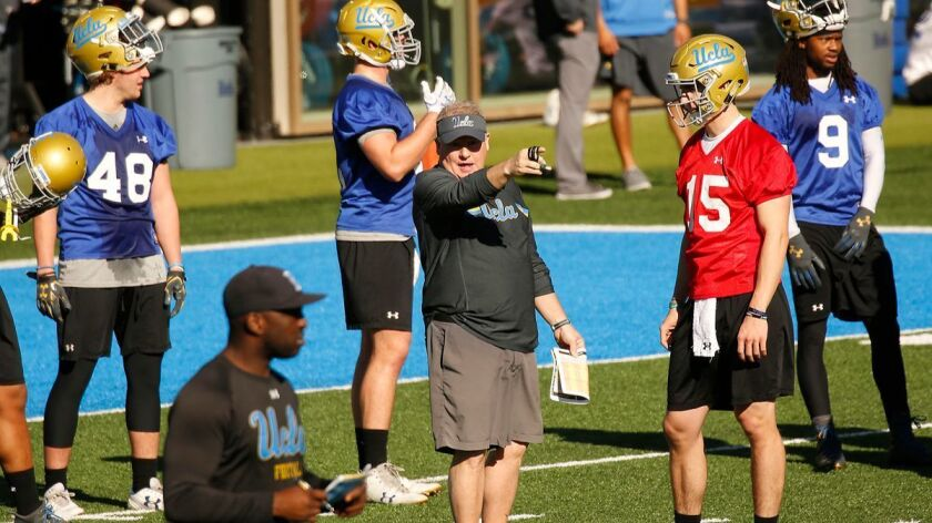 WESTWOOD, CA - MARCH 06, 2018 - New Head Coach of UCLA Football Chip Kelly, center, works with one o