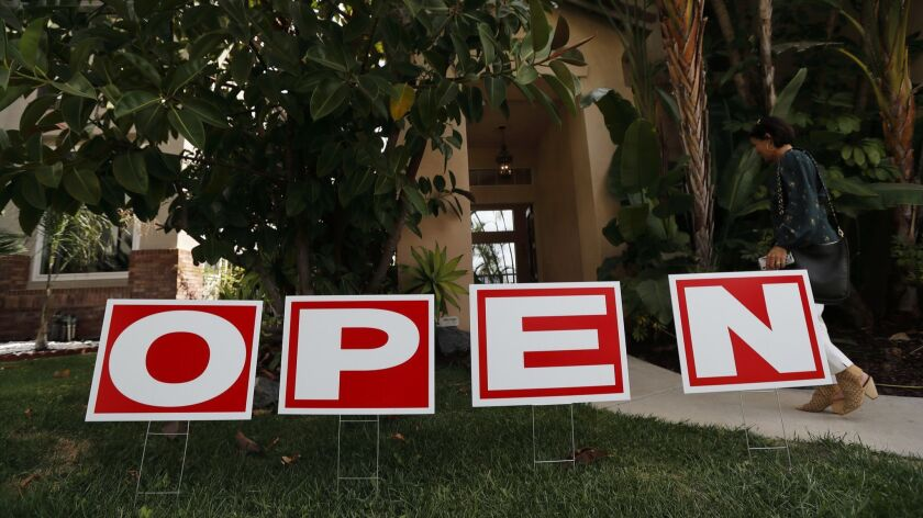 A lawn sign advertises an open house for a home for sale in Chula Vista, Calif. in October.