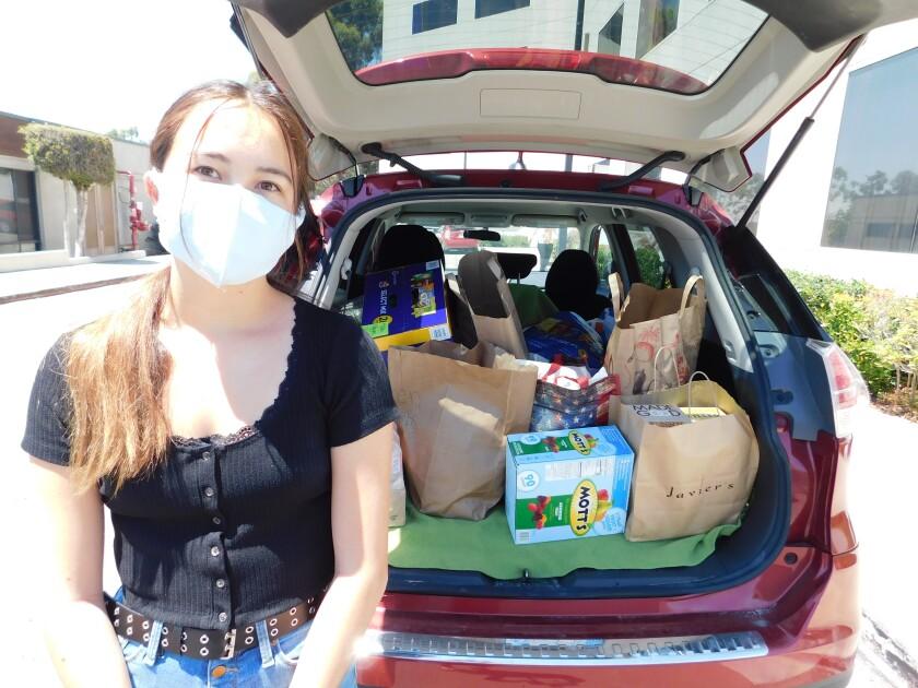 Ella Adams delivers a carload of Hospital Helpers donations.