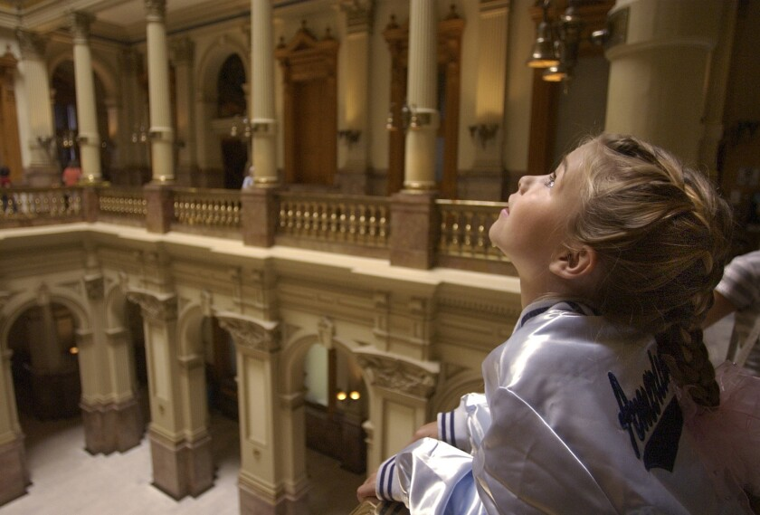 Lily Thorpe of Grand Junction, Colo., visits the state Capitol in Denver. Colorado could become the first state to have its Legislature led by two Latinas.