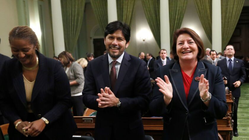 Sen. Kevin de León, D-Los Angeles, and Assemblywoman Toni Atkins, D-San Diego applaud Gov. Jerry Brown, before his 2014 State of the State Address before a joint session of the California legislature.
