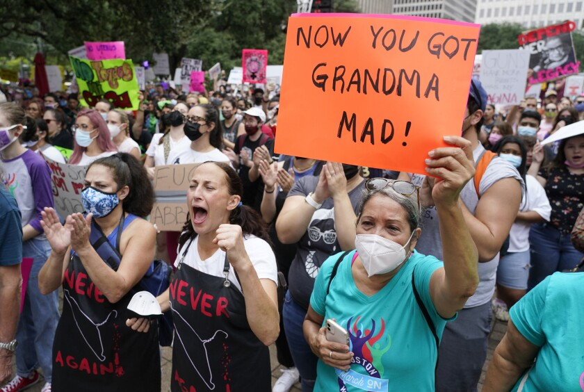 People participating in the Houston Women's March against Texas abortion ban listen to speakers at City Hall Saturday, Oct. 2, 2021, in Houston. (Melissa Phillip/Houston Chronicle via AP)