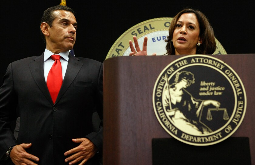 Antonio Villaraigosa, then Los Angeles mayor, listens to state Atty. Gen. Kamala D. Harris at a 2011 news conference on mortgage fraud in Los Angeles.