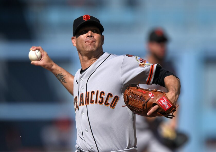 San Francisco Giants starting pitcher Tim Hudson throws to the plate during the first inning of a baseball game against the Los Angeles Dodgers, Saturday, June 20, 2015, in Los Angeles. (AP Photo/Mark J. Terrill)