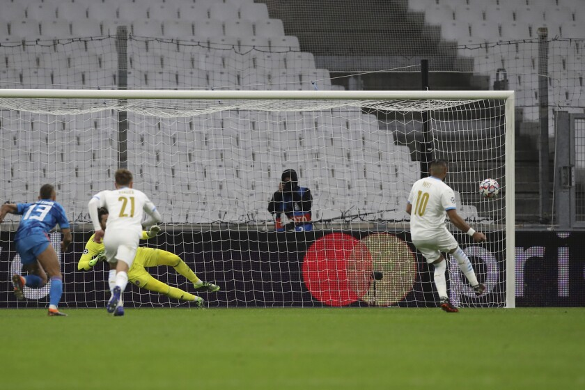 Marseille's Dimitri Payet shoots a penalty to score the first goal of his side during the Champions League group C soccer match between Olympique Marseille and Olympiacos at the Velodrome stadium in Marseille, southern France, Tuesday, Dec. 1, 2020. (AP Photo/Daniel Cole)