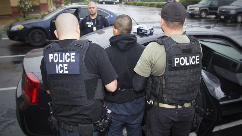 A Sacramento man filed a claim Wednesday alleging U.S. Immigration and Customs Enforcement agents beat him to force his cooperation as an informant. In this 2017 photo, agents arrest a man during an enforcement operation in L.A.