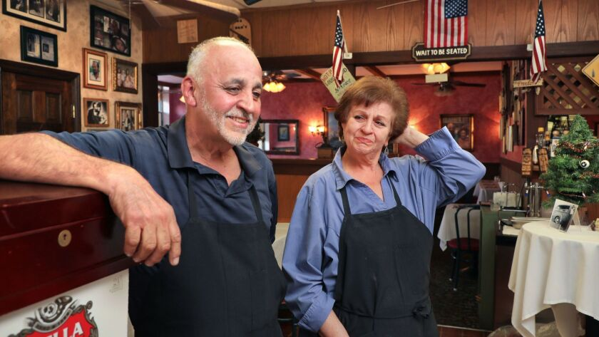 Cathy Parisi gets emotional as her brother Sam Feliccia speaks about the many years he and his wife Nina have run Feliccia's Italian Restaurant and Deli that's closing December 13th. after 40 years