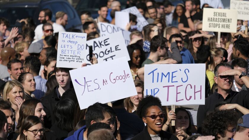 Google employees hold up signs during a Nov. 1 walkout in San Francisco.