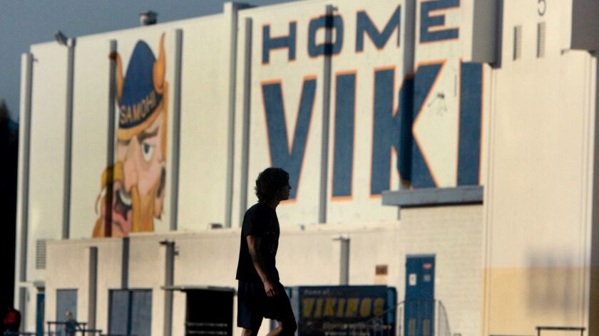 A student practices on the field on the campus of Santa Monica High School.