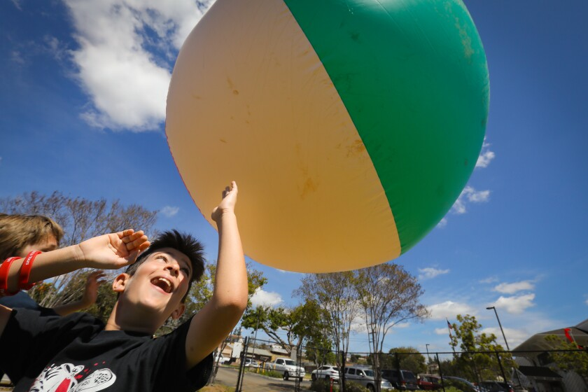 During the TEDxKids@ElCajon held at Greenfield Middle School, third-grader Mohammed Mohammed was one of the students who tired to keep a giant beach ball off the ground for as long as possible without holding it after it was dropped from a few feet.