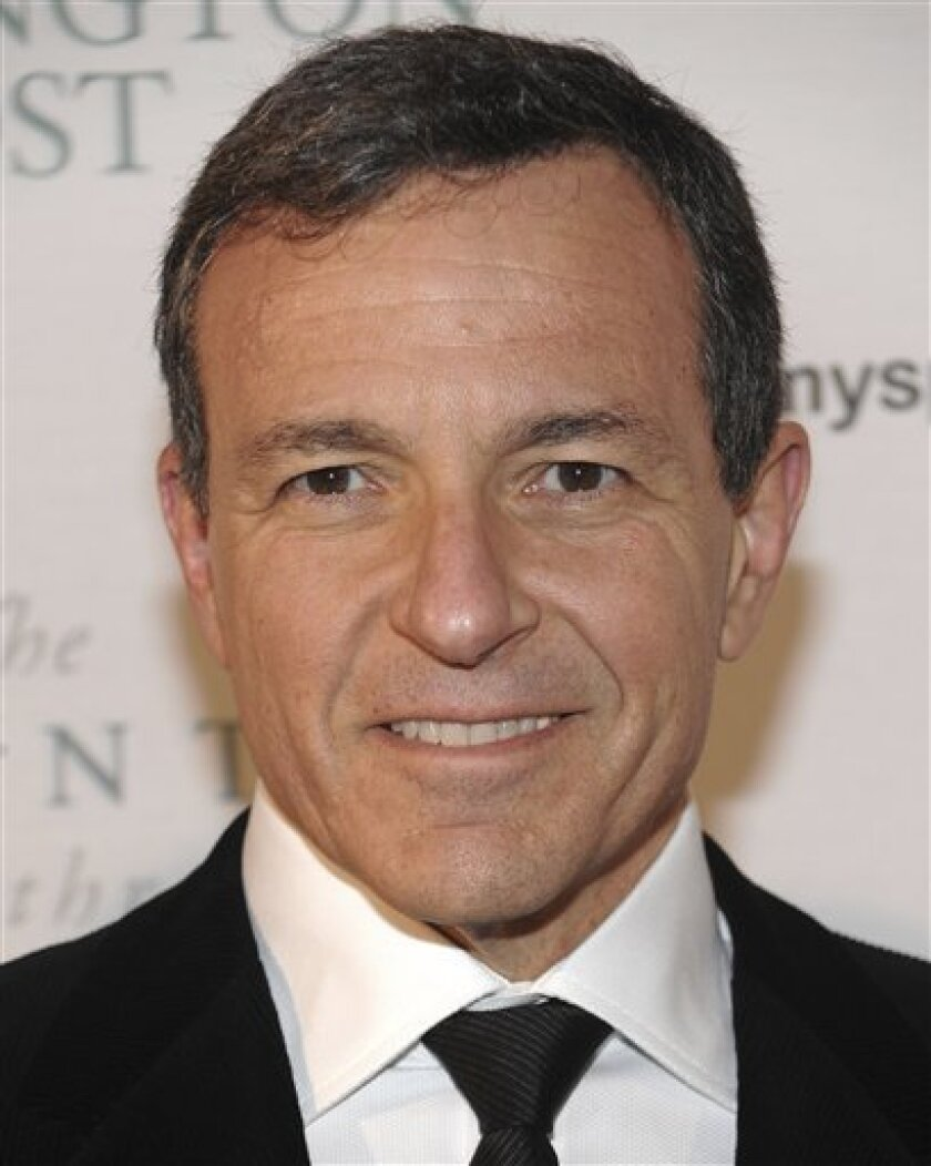 FILE - In this Jan. 19, 2009 file photo, Walt Disney Company president and CEO Robert Iger attends the Huffington Post Pre-Inaugural Ball at the Newseum in Washington. (AP Photo/Evan Agostini, file)